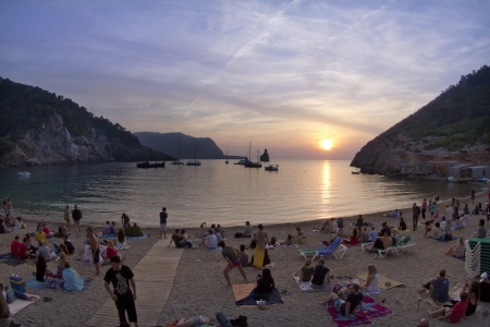 benirras beach in ibiza, popular for crowds to gather at sunset Editorial