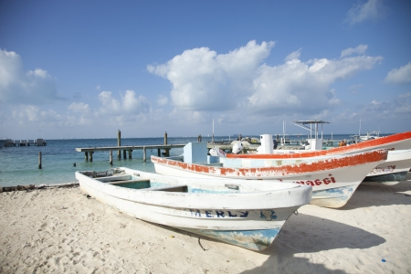 dolly: fishing boats on the beach in isla mujeres mexico. beautiful colours. Editorial