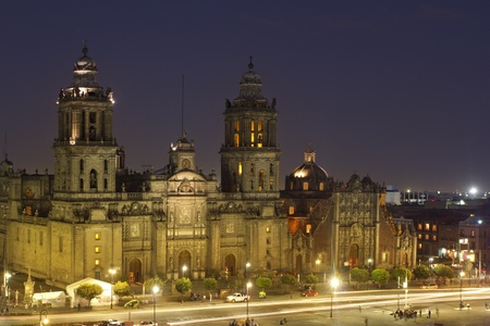the zocalo in mexico city at night, with the cathedral and giant flag in the centre