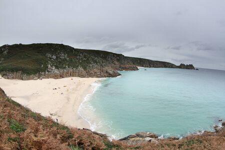 porthcurno: the stunning coastline at porthcurno on the cornwall coast, england Stock Photo