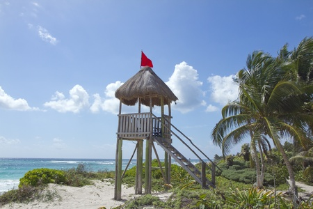 hedonistic: perfect paradise beach with a wooden lifeguards tower, mexican caribbean coast