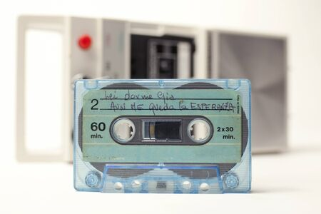 eject: an old audio cassette in front of a retro tape player