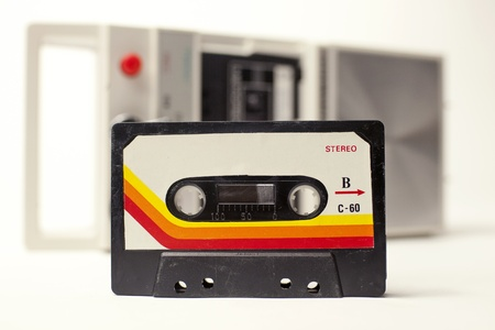 tape player: an old audio cassette in front of a retro tape player