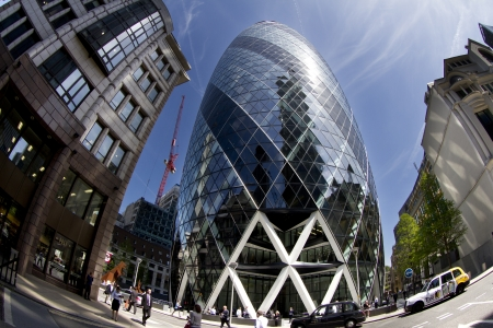 fisheye shot looking up to the gherkin buiding in london Editorial