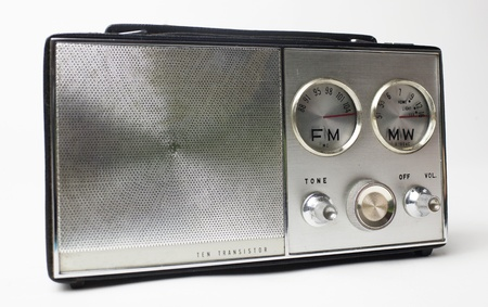 a great looking vintage portable silver radio with cool FM and MW dials photo