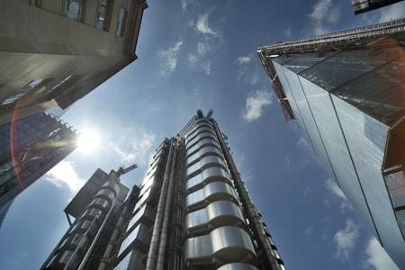 lloyds of london: fisheye shot of londons financial centre focusing on lloyds of london building