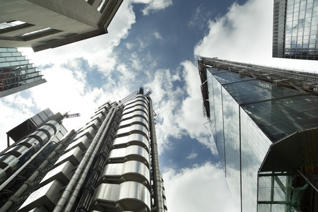 fisheye shot of londons financial centre focusing on lloyds of london building