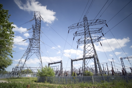 high powered: electricity pylons and a power station in england