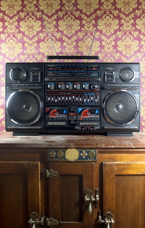 blaster: a fantastic looking retro ghetto blaster radio with wallpaper background Stock Photo