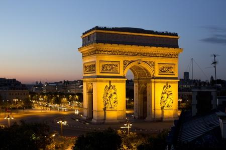 triumphe: the arc de triomphe in paris, france at sunset Editorial