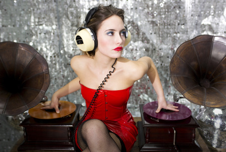 beautful sexy disco dj in red dress with gramophones. Perfect for stylish club, disco and fashion events  photo