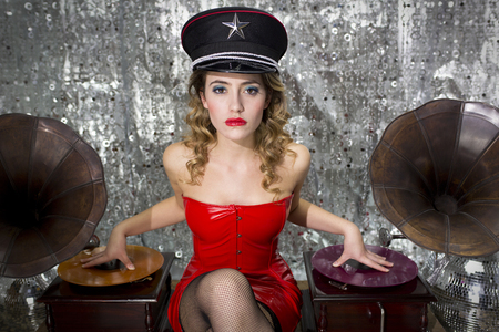 beautful sexy disco dj in red dress and military hat with gramophones. Perfect for stylish club, disco and fashion events  photo