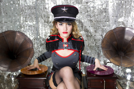 beautiful sexy disco dj in military uniform and hat with gramophones. Perfect for stylish club, disco and fashion events  photo