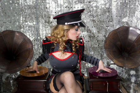 beautful sexy disco dj in military uniform and hat with gramophones. Perfect for stylish club, disco and fashion events  photo