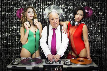 amazing grandpa DJ and his two beauitful gogo dancers photo