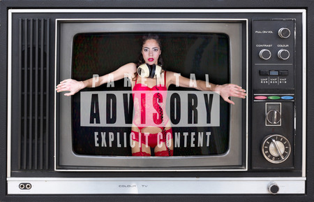 beautiful sexy woman in red lingerie dancing stuck inside retro televison Stock Photo