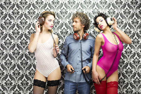 man with 2 beautiful disco dancers photo