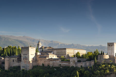 ramparts: shot of the alhambra palace in granada with the sierra nevada mountains in the distance