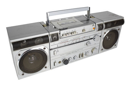 airwaves: a vintage tape player and radio against black