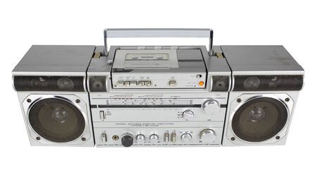 transistor: a vintage tape player and radio against black
