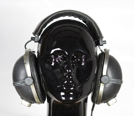 hedonistic: a cool female mannequin head with headphones