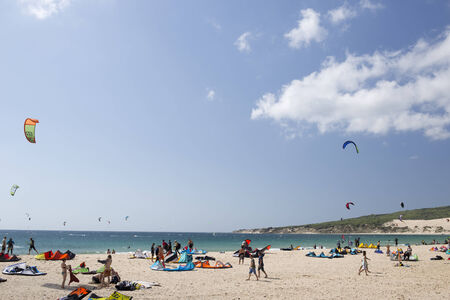 tarifa: a large beach filled with kite surfers in tarifa, one of europes most popular areas for the sport