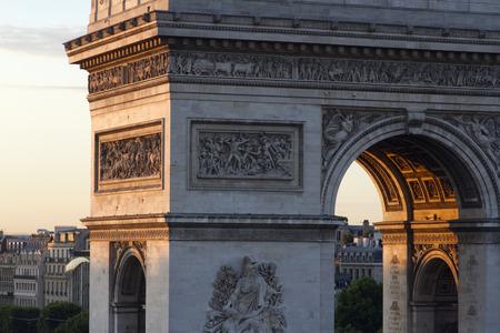 triumphe: close-up of the arc de triomphe in paris, france at sunrise Editorial