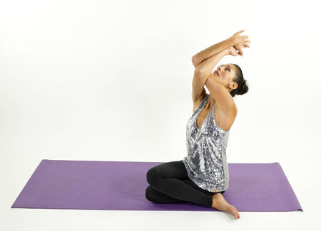 moves: young woman practices yoga moves and positions in a studio setting