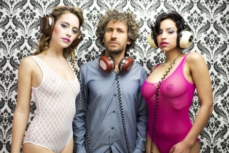 threesome: lucky man with 2 beautiful sexy disco dancers Stock Photo