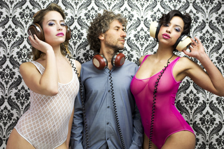 lucky man with 2 beautiful sexy disco dancers Imagens