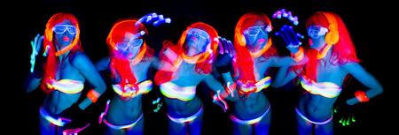 disco: sexy female disco dancer poses in UV costume