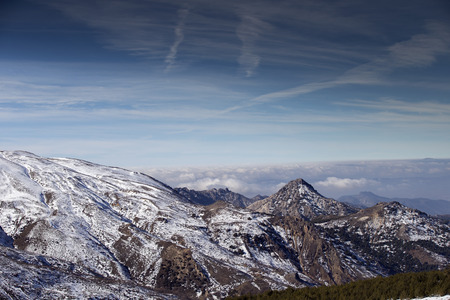 sierra snow: view of mountains and clouds in the sierra nevada, spain