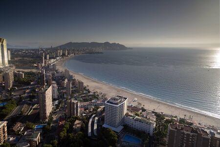 seaside resort: the coast and high rise skyline of benidorm seaside resort, spain at sunrise