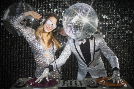 dj party: introducing mr and mrs discoball. two cool club characters DJing in a club