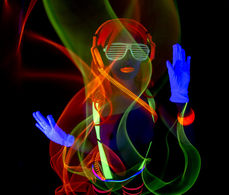 sexy female disco dancer poses in UV costume