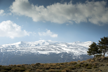 sierra nevada: view of mountians and clouds in the sierra nevada, spain Stock Photo