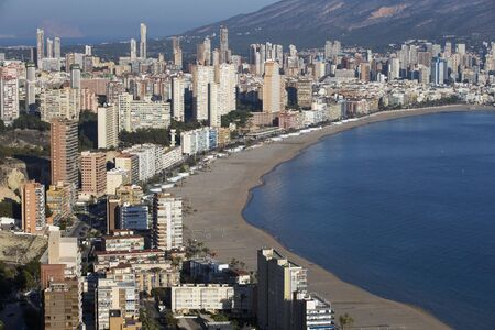seaside resort: the coast and high rise skyline of benidorm seaside resort, spain Stock Photo
