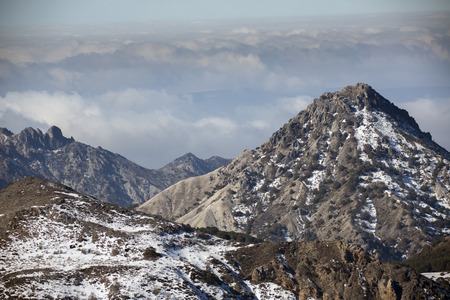 sierra snow: view of mountians and clouds in the sierra nevada, spain Stock Photo