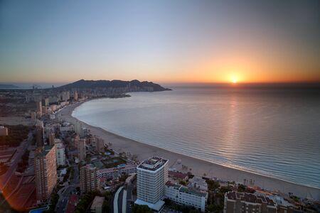 seaside resort: the coast and high rise skyline of benidorm seaside resort, spain at sunset