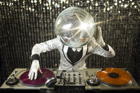 dancing club: introducing mr discoball. a cool club character DJing in a club