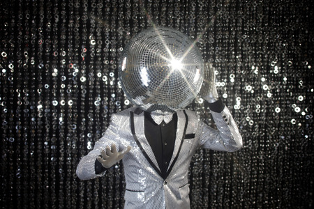 mirror ball: mr discoball. a super cool disco club character against sparkling background Stock Photo