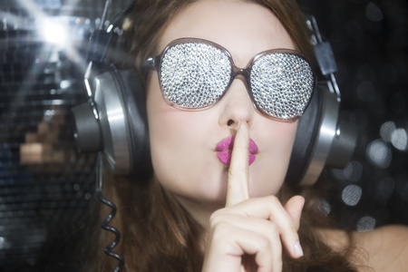 discoball: beautiful sexy disco woman, listening to music with sparkle covered sunglasses. Perfect for stylish club, disco and fashion events