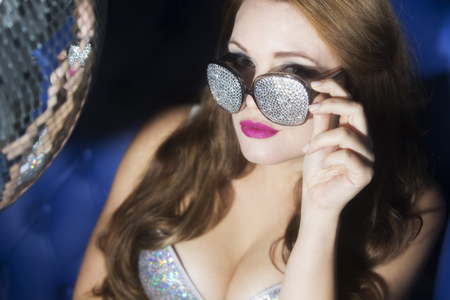 mirrorball: beautiful sexy disco woman, with sparkle covered sunglasses. Perfect for stylish club, disco and fashion events