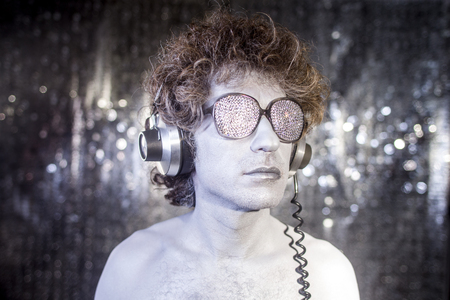 go go dancer: a cool silver club character listening to music in a disco setting