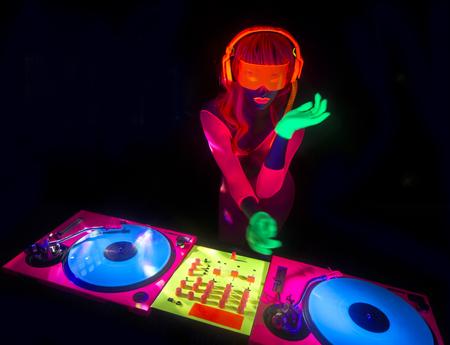female DJ mixes in a club in UV fluorescent costume