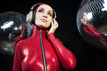 catsuit: sexy disco woman in a red catsuit surrounded by discoballs. Perfect for stylish club, disco and fashion events