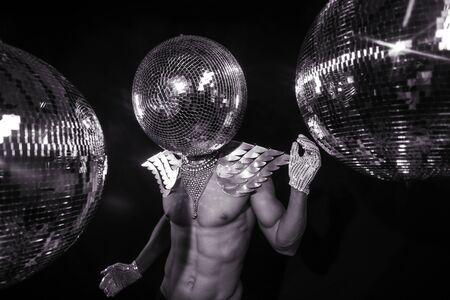 erotic fantasy: mr. discoball, disco party superhero Stock Photo
