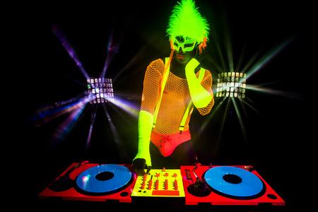 dj male disco dancer play records in UV costume