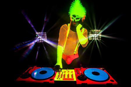 space age: dj sexy male disco dancer play records in UV costume