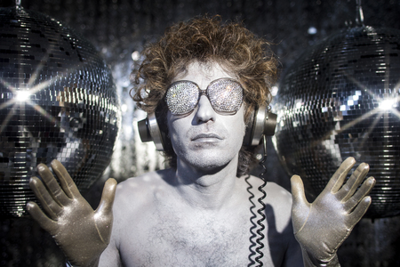 discoball: a cool silver club character listening to music in a disco setting